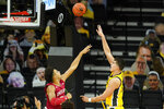 Iowa center Luka Garza shoots over Indiana forward Trayce Jackson-Davis, left, during the first half of an NCAA college basketball game, Thursday, Jan. 21, 2021, in Iowa City, Iowa. (AP Photo/Charlie Neibergall)