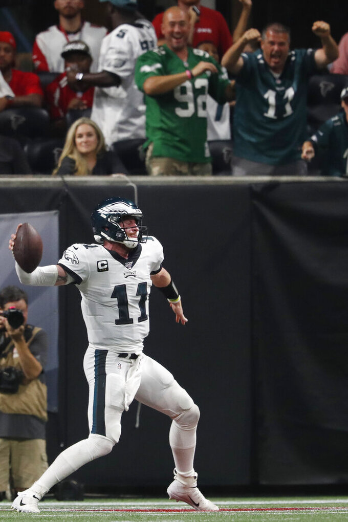 Philadelphia Eagles quarterback Carson Wentz (11) spikes the ball after a touchdown against the Atlanta Falcons during the second half of an NFL football game, Sunday, Sept. 15, 2019, in Atlanta. (AP Photo/John Bazemore)