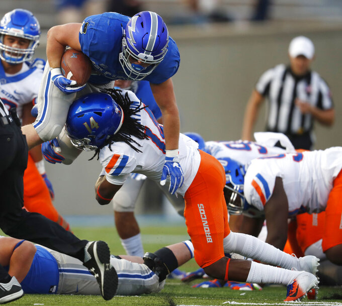 Boise State cornerback Tyler Horton, right, tackles Air Force fullback Cole Fagan after a short gain in the first half of an NCAA college football game Saturday, Oct. 27, 2018, at Air Force Academy, Colo. (AP Photo/David Zalubowski)