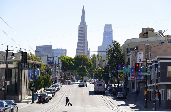 FILE - This Oct. 11, 2020, file photo shows the Transamerica Pyramid, center, and Salesforce Tower above Columbus Avenue in San Francisco. The Transamerica Pyramid, one of San Francisco's iconic buildings, has sold for $650 million, eight months after a sales agreement was reached. (AP Photo/Eric Risberg, File)