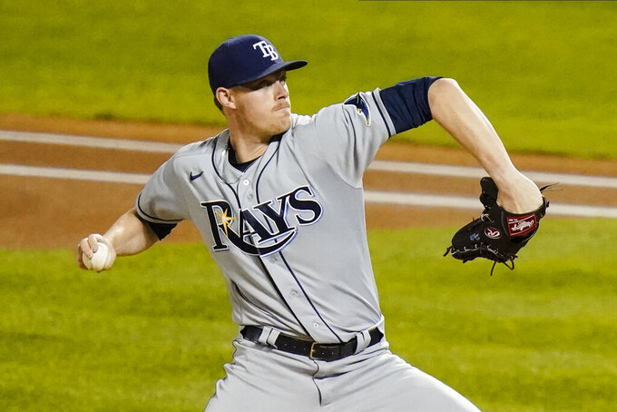 Tampa Bay Rays' Peter Fairbanks delivers a pitch during the first inning of a baseball game against the New York Mets Monday, Sept. 21, 2020, in New York. (AP Photo/Frank Franklin II)