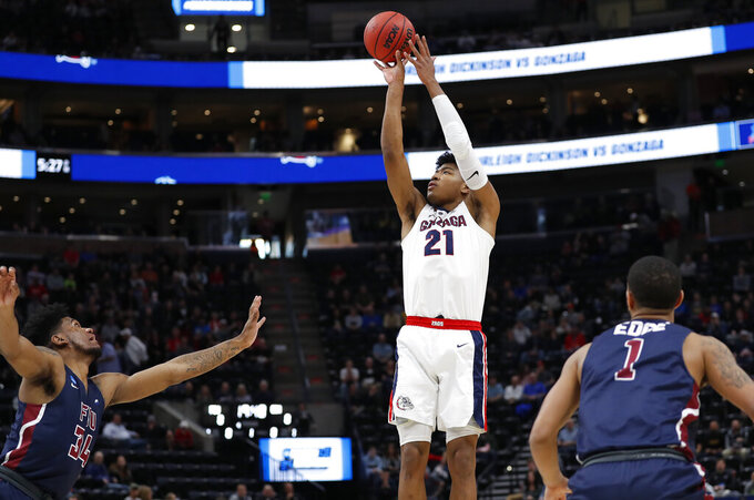 Gonzaga forward Rui Hachimura (21) shoots against Fairleigh Dickinson forward Mike Holloway Jr. (34) and guard Darnell Edge (1) during the first half of a first-round game in the NCAA men's college basketball tournament Thursday, March 21, 2019, in Salt Lake City. (AP Photo/Jeff Swinger)