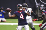 Houston Texans quarterback Deshaun Watson (4) throws against the Jacksonville Jaguars during the first half of an NFL football game Sunday, Oct. 11, 2020, in Houston. (AP Photo/Eric Christian Smith)