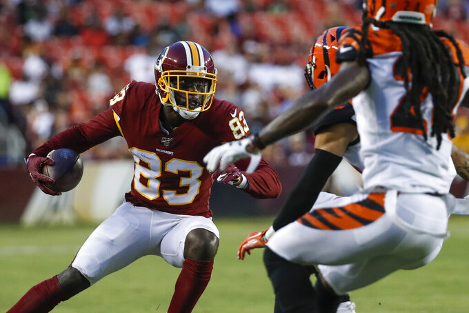 Washington Redskins wide receiver Brian Quick (83) tries to get away from Cincinnati Bengals safety Jessie Bates III and cornerback B.W. Webb (24) during the first half of an NFL preseason football game Thursday, Aug. 15, 2019, in Landover, Md. (AP Photo/Alex Brandon)