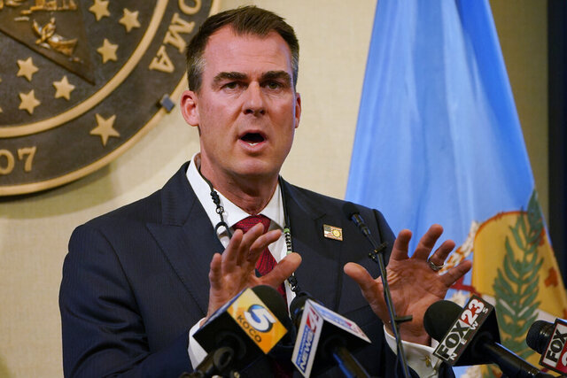 Oklahoma Gov. Kevin Stitt speaks during a news conference in Oklahoma City, Monday, Nov. 16, 2020. Stitt is imposing new restrictions on bars and restaurants and requiring masks in state buildings as officials attempt to control the surging number of coronavirus infections. (AP Photo/Sue Ogrocki)