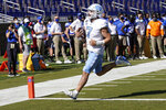North Carolina  quarterback Sam Howell (7) scores a touchdown against the Duke Blue during the first half of an NCAA college football game at Wallace Wade Stadium, Saturday, Nov. 7, 2020, in Durham, N.C. (Jim Dedmon/Pool Photo via AP)