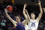 Saint Mary's Kyle Bowen (14) and BYU's Gavin Baxter (25) reach for a rebound during the first half of an NCAA college basketball game in the West Coast Conference tournament, Monday, March 9, 2020, in Las Vegas. (AP Photo/Isaac Brekken)