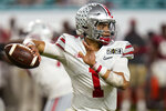 Ohio State quarterback Justin Fields passes against Alabama during the second half of an NCAA College Football Playoff national championship game, Monday, Jan. 11, 2021, in Miami Gardens, Fla. (AP Photo/Chris O'Meara)