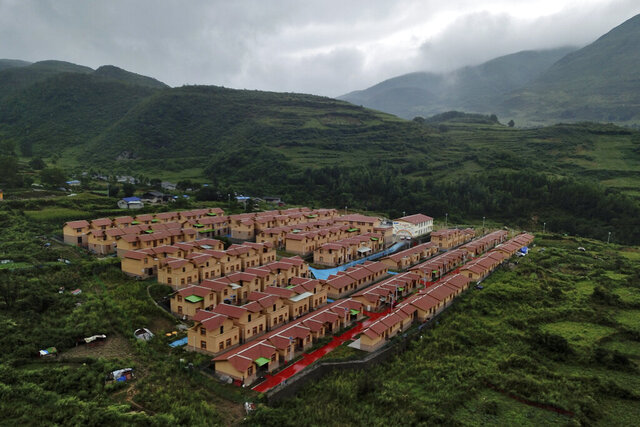 An aerial view shows new village houses built by the Chinese government for ethnic minority in Ganluo county, southwest China's Sichuan province on Sept. 10, 2020. China's ruling Communist Party says its initiatives have helped to lift millions of people out of poverty. Yi ethnic minority members were moved out of their mountain villages in China's southwest and into the newly built town in an anti-poverty initiative. (AP Photo/Sam McNeil)