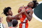 Michigan State guard A.J. Hoggard, left, and Illinois guard Ayo Dosunmu fight for control of the ball during the first half of an NCAA college basketball game, Tuesday, Feb. 23, 2021, in East Lansing, Mich. (AP Photo/Carlos Osorio)