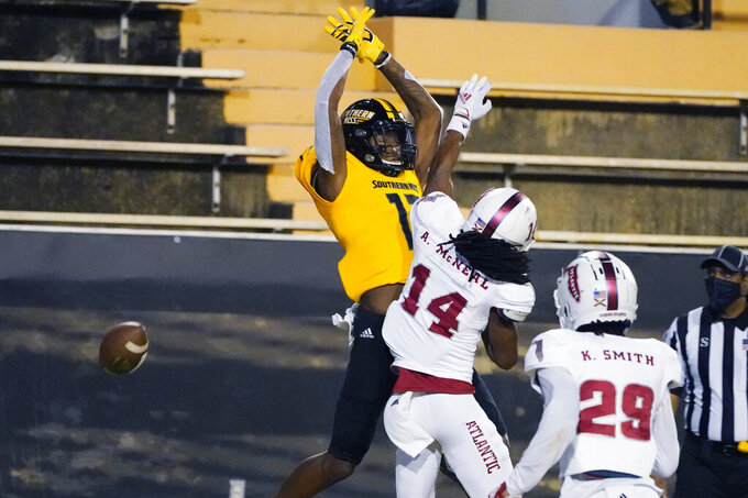Florida Atlantic cornerback Ashton McNeal (14) defends against Southern Mississippi wide receiver Jason Brownlee (17) as a pass falls incomplete during the first half of an NCAA college football game Thursday, Dec. 10, 2020, in Hattiesburg, Miss. (AP Photo/Rogelio V. Solis)