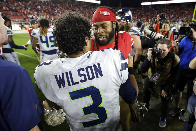 Seattle Seahawks quarterback Russell Wilson (3) greets San Francisco 49ers cornerback Richard Sherman after an NFL football game in Santa Clara, Calif., Monday, Nov. 11, 2019. The Seahawks won 27-24 in overtime. (AP Photo/Ben Margot)
