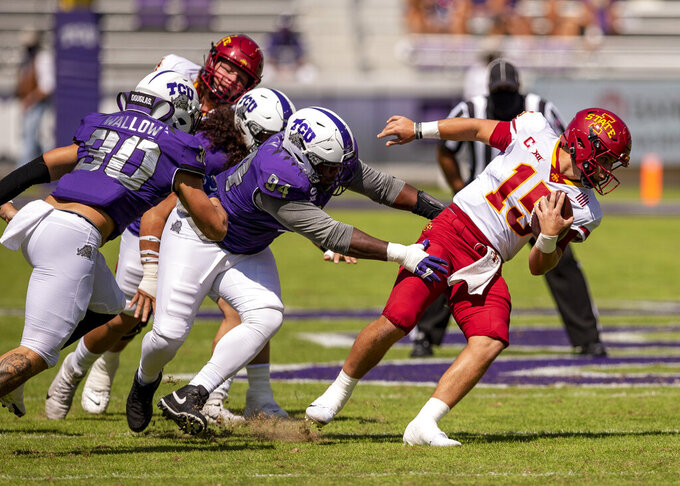 Iowa State quarterback Brock Purdy (15) spins away from TCU defensive tackle Corey Bethley (94) during an NCAA football game on Saturday, Sept. 26, 2020 in Fort Worth, Texas. (AP Photo/Brandon Wade)