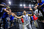 Kentucky's Jemarl Baker Jr. (13) is greeted by fans as he leaves the court after defeating Wofford in a second-round game in the NCAA men's college basketball tournament in Jacksonville, Fla., Saturday, March 23, 2019. (AP Photo/Stephen B. Morton)