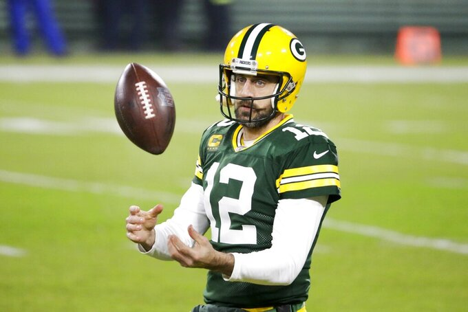 Green Bay Packers' Aaron Rodgers warms up before an NFL football game against the Carolina Panthers Saturday, Dec. 19, 2020, in Green Bay, Wis. (AP Photo/Mike Roemer)
