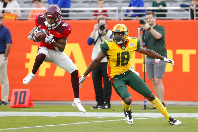 FILE - In this March 10, 2019, file photo, San Antonio Commanders defensive back De'Vante Bausby (41) intercepts the ball that was intended for Arizona Hotshots wide receiver Marquis Bundy (18) in the first half during an AAF football game at Sun Devil Stadium in Phoenix. Bausby signed with the NFL's Denver Broncos. Not all the AAF exiles were able to secure a new job so quickly, if at all, but for those that played in the failed developmental league it at least provided some bonus playing time even if the experience so ended abruptly and awkwardly. (AP Photo/Rick Scuteri, File)