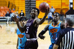 Texas Southern's Justin Hopkins (15) reaches for the ball in front of Oklahoma State guards Avery Anderson III, left, and Ferron Flavors Jr. (31) in the first half of an NCAA college basketball game in Stillwater, Okla., Saturday, Nov. 28, 2020. (AP Photo/Sue Ogrocki)