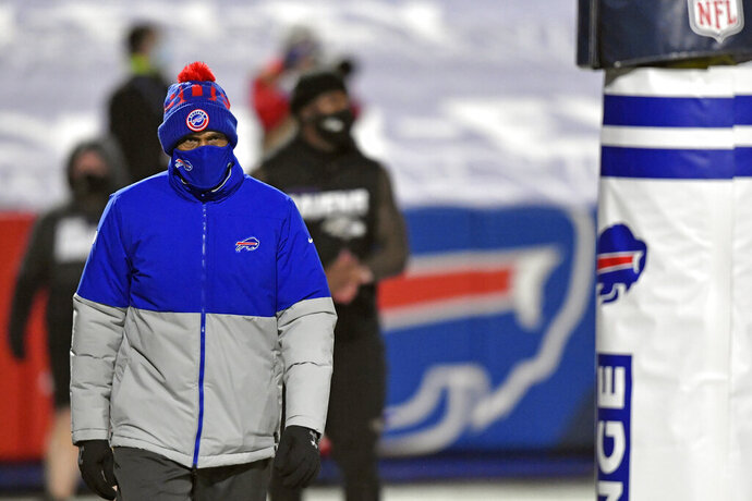 Buffalo Bills Defensive Coordinator Leslie Frazier walks the field before an NFL divisional round football game against the Baltimore Ravens Saturday, Jan. 16, 2021, in Orchard Park, N.Y. All four defensive coordinators who will be trying to shut down high-powered offenses in the NFL playoffs this weekend have been head coaches before, providing valuable experience in the conference championships.(AP Photo/Adrian Kraus)