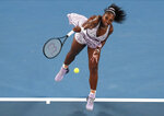 Serena Williams of the U.S. serves to Slovenia's Tamara Zidansek during their second round singles match at the Australian Open tennis championship in Melbourne, Australia, Wednesday, Jan. 22, 2020. (AP Photo/Lee Jin-man)