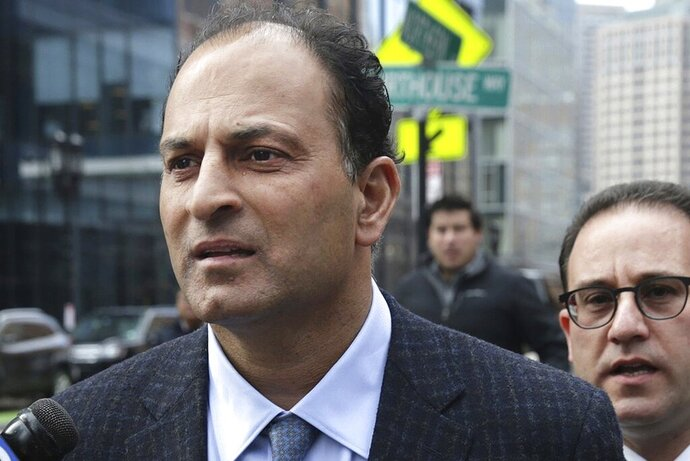 FILE - March 15, 2019, David Sidoo, of Vancouver, Canada, leaves following his federal court hearing in a nationwide college admissions cheating scheme in Boston. Sidoo pleaded guilty to charges in March and is scheduled to be sentenced on Wednesday, July 15, 2020, for paying to have someone take a college entrance exam in place of his two sons. (Jonathan Wiggs/The Boston Globe via AP, File)