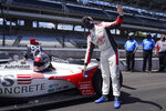 Marco Andretti reacts after winning the pole for the Indianapolis 500 auto race at Indianapolis Motor Speedway, Sunday, Aug. 16, 2020, in Indianapolis. (AP Photo/Darron Cummings)