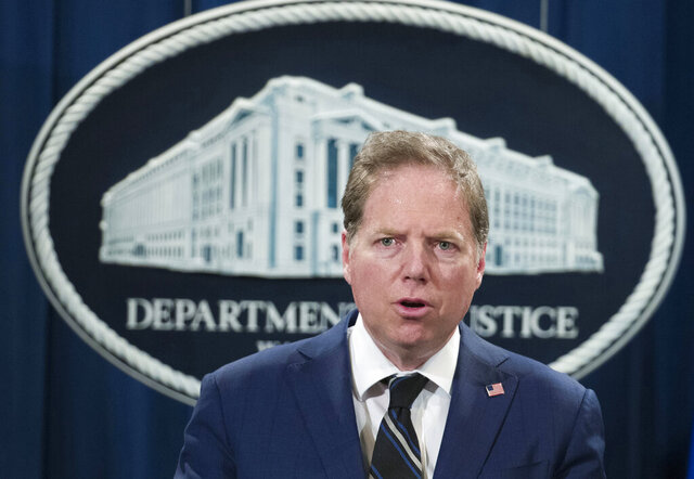 FILE - In this Oct. 26, 2018, file photo, Geoffrey Berman, U.S. attorney for the Southern District of New York, speaks during a news conference at the Department of Justice in Washington. Berman, who oversaw key prosecutions of allies of President Donald Trump and an investigation into Trump's personal lawyer Rudy Giuliani, is resigning. Attorney General William Barr said Friday, June 19, 2020, that Trump intends to nominate Jay Clayton, the chair of the Securities and Exchange Commission, to the post. (AP Photo/Alex Brandon, File)