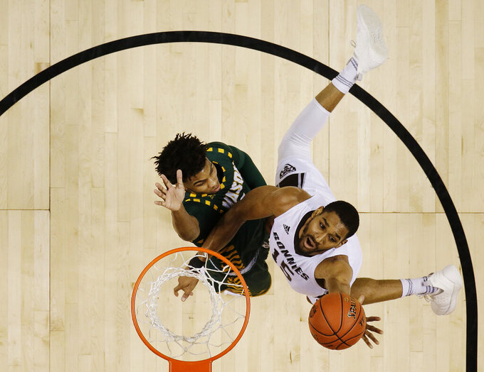 St. Bonaventure's LaDarien Griffin, right, drives past George Mason's Justin Kier during the first half of an NCAA college basketball game in the Atlantic 10 men's tournament Friday, March 15, 2019, in New York. St. Bonaventure won 68-57. (AP Photo/Frank Franklin II)