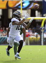 FILE - In this Sept. 30, 2018, file photo, Jacksonville Jaguars wide receiver Donte Moncrief (10) catches a pass for a 67-yard touchdown in front of New York Jets cornerback Trumaine Johnson (22) during the second half of an NFL football game in Jacksonville, Fla. The Pittsburgh Steelers began the process of moving on after trading star wide receiver Antonio Brown to Oakland by signing veteran Donte Moncrief to a two-year contract. (AP Photo/Phelan M. Ebenhack, File)
