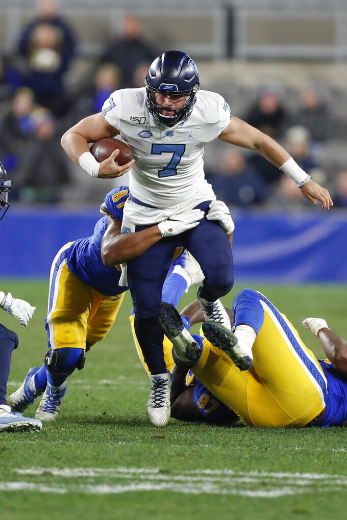 North Carolina quarterback Sam Howell (7) is sacked by Pittsburgh defensive lineman Jaylen Twyman (97) during the first half of an NCAA football game, Thursday, Nov. 14, 2019, in Pittsburgh. (AP Photo/Keith Srakocic)