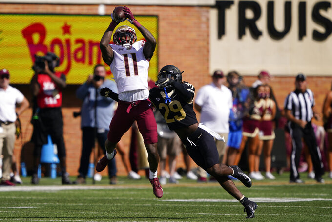 Florida State wide receiver Malik McClain (11) catches a pass over Wake Forest defensive back Caelen Carson during the first half of an NCAA college football game Saturday, Sept. 18, 2021, in Winston-Salem, N.C. (AP Photo/Chris Carlson)