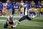 FILE - In this Feb. 3, 2019, file photo, New England Patriots' Stephen Gostkowski (3) kicks a field goal as Ryan Allen (6) holds during the second half of the team's NFL Super Bowl 53 football game against the Los Angeles Rams in Atlanta.No one has played in more Super Bowls with Tom Brady than Stephen Gostkowski, who went with him six times during their tenures in New England. (AP Photo/Mark Humphrey, File)