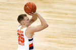 Syracuse guard Buddy Boeheim (35) takes a three point shot during the second half of an NCAA college basketball game against North Carolina State in the second round of the Atlantic Coast Conference tournament in Greensboro, N.C., Wednesday, March 10, 2021. (AP Photo/Gerry Broome)