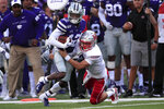 Kansas State defensive back AJ Parker (12) is tackled by Nicholls State running back Kendall Bussey, right, after an interception during the first half of an NCAA college football game in Manhattan, Kan., Saturday, Aug. 31, 2019. (AP Photo/Orlin Wagner)