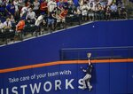 Fans watch as Atlanta Braves' Austin Riley chases a ball hit by New York Mets' Pete Alonso for a home run during the fourth inning of a baseball game Friday, June 28, 2019, in New York. (AP Photo/Frank Franklin II)