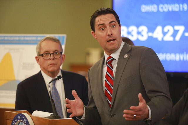 Moments after announcing the possible extension of Ohio voting until June 2, Ohio Secretary of State Frank LaRose answers a reporter's question at a coronavirus news conference Saturday, March 14, 2020 at the Ohio Statehouse. (Doral Chenoweth/The Columbus Dispatch via AP)