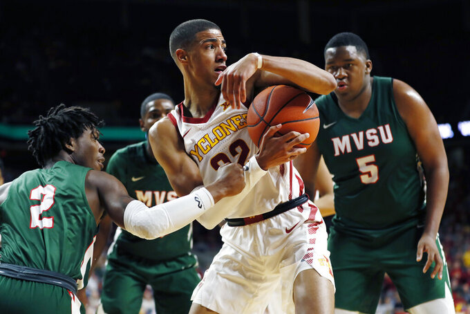 Iowa State guard Tyrese Haliburton, center, grabs a rebound between Mississippi Valley State's Brandon Kimble, left, and Richard Rivers Jr., right, during the first half of an NCAA college basketball game, Tuesday, Nov. 5, 2019, in Ames, Iowa. (AP Photo/Charlie Neibergall)