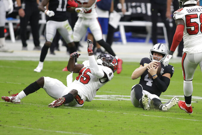 Tampa Bay Buccaneers inside linebacker Devin White (45) sacks Las Vegas Raiders quarterback Derek Carr (4) during the first half of an NFL football game, Sunday, Oct. 25, 2020, in Las Vegas. (AP Photo/Isaac Brekken)