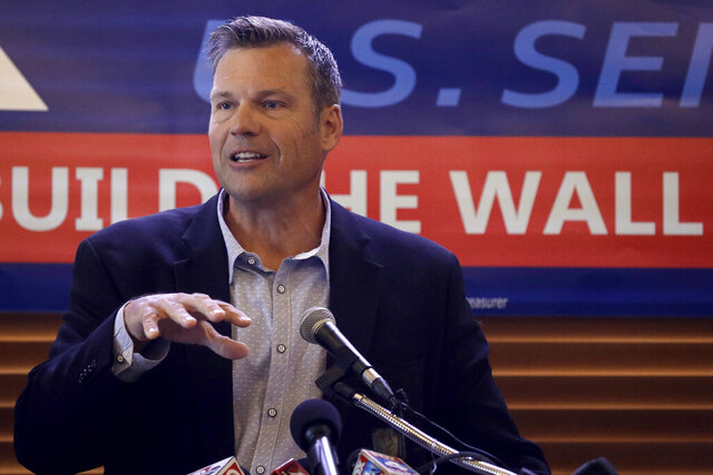 FILE _ in this Monday, July 8, 2019 file photo, former Kansas Secretary of State Kris Kobach addresses the crowd as he announces his candidacy for the Republican nomination for the U.S. Senate in Leavenworth, Kan. Kobach isn't fazed that fellow Republicans worry he's unpopular or too brash in pushing his hard-right views to keep Kansas' open U.S. Senate seat in GOP hands next year. (AP Photo/Charlie Riedel, File)