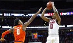 North Carolina State's C.J. Bryce (13) attempts a shot over Clemson's Clyde Trapp (0) during the first half of an NCAA college basketball game in Raleigh, N.C., Saturday, Jan. 26, 2019. (AP Photo/Ben McKeown)