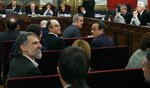 Jordi Cuixart, president of the Catalan Omnium Cultural organization, left, sits next to other eleven separatist leaders during the trial at the Spanish Supreme Court in Madrid, Tuesday, Feb. 12, 2019. Spain is bracing for the nation's most sensitive trial in four decades of democracy this week, with a dozen Catalan separatists facing charges including rebellion over a failed secession bid in 2017. (J.J. Guillen/Pool via AP)