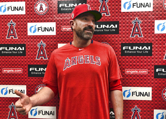 Los Angeles Angels pitching coach Mickey Callaway speaks about his philosophies outside the clubhouse at Tempe Diablo Stadium in Tempe, Ariz., on Friday, Feb. 14, 2020. After his difficult two-year tenure as the New York Mets' manager ended last fall, Callaway says he is energized by his return to a familiar role as he becomes a key assistant to new Angels manager Joe Maddon. (AP Photo/Greg Beacham)