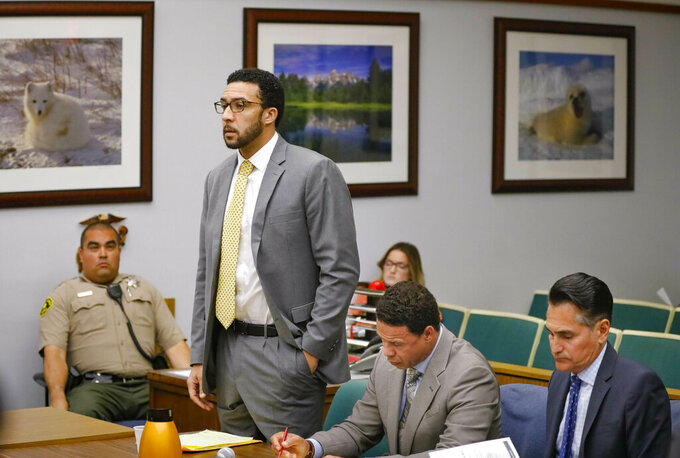 Ex-NFL player Kellen Winslow II, standing, who was accused of committing several sex crimes against women in North County last year, including rape, answers a question from San Diego County Superior Court Vista Judge Blaine Bowman during a status hearing Friday, June 14, 2019 in Vista, Calif. (Howard Lipin/The San Diego Union-Tribune via AP, Pool)