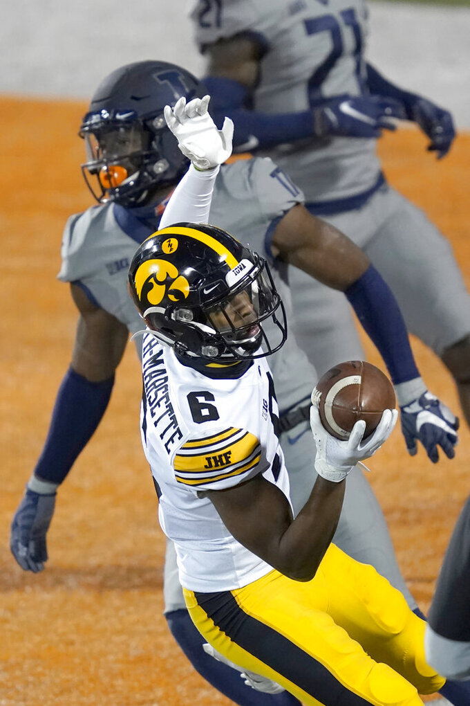 Iowa wide receiver Ihmir Smith-Marsette catches a touchdown pass during the second half of an NCAA college football game against Illinois Saturday, Dec. 5, 2020, in Champaign, Ill. Iowa won 35-21. (AP Photo/Charles Rex Arbogast)