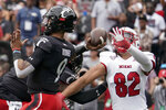 Cincinnati quarterback Desmond Ridder (9) throws a pass during the first half an NCAA college football game against Miami (Ohio), Saturday, Sept. 4, 2021, in Cincinnati. (AP Photo/Jeff Dean)
