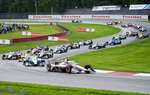 Will Power (12), of Australia, leads the pack at the beginning of an IndyCar Series auto race at Mid-Ohio Sports Car Course, Saturday, Sept. 12, 2020, in Lexington, Ohio. (AP Photo/Phil Long)