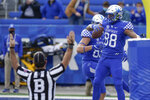 Kentucky tight end Keaton Upshaw (88) and tight end Justin Rigg (83) celebrate after Upshaw scored a touchdown during the first half of an NCAA college football game against Vanderbilt, Saturday, Nov. 14, 2020, in Lexington, Ky. (AP Photo/Bryan Woolston)