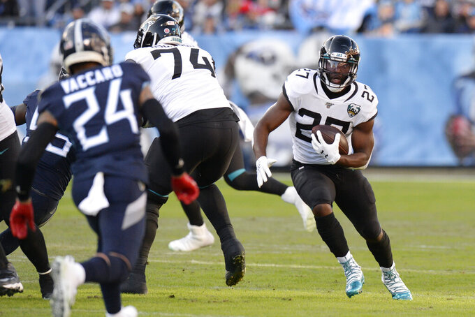 Jacksonville Jaguars running back Leonard Fournette (27) carries the ball against the Tennessee Titans in the first half of an NFL football game Sunday, Nov. 24, 2019, in Nashville, Tenn. (AP Photo/Mark Zaleski)