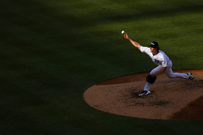 New York Yankees pitcher Gerrit Cole delivers a pitch during the fourth inning of the first baseball game of a doubleheader against the Baltimore Orioles, Friday, Sept. 11, 2020, in New York. (AP Photo/Adam Hunger)