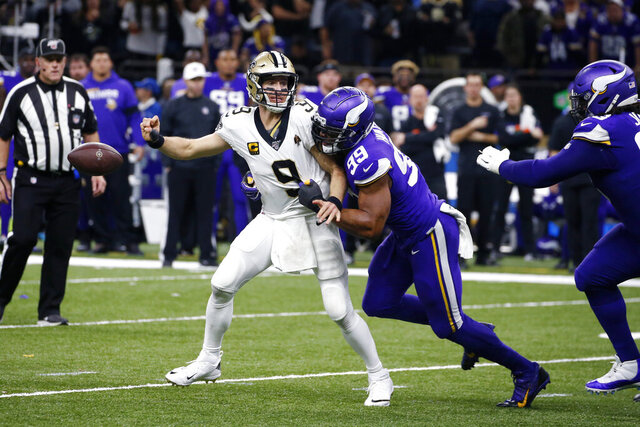 New Orleans Saints quarterback Drew Brees (9) fumbles as he is hit by Minnesota Vikings defensive end Danielle Hunter (99) in the second half of an NFL wild-card playoff football game, Sunday, Jan. 5, 2020, in New Orleans. (AP Photo/Butch Dill)