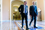 Sen. Mike Lee, R-Utah, left, and Sen. Rick Scott, R-Fla., right, walk out of a meeting in the office of Senate Minority Leader Mitch McConnell of Ky. as the $1 trillion bipartisan infrastructure bill gets closer to passage in Washington, Monday, Aug. 9, 2021. (AP Photo/Andrew Harnik)